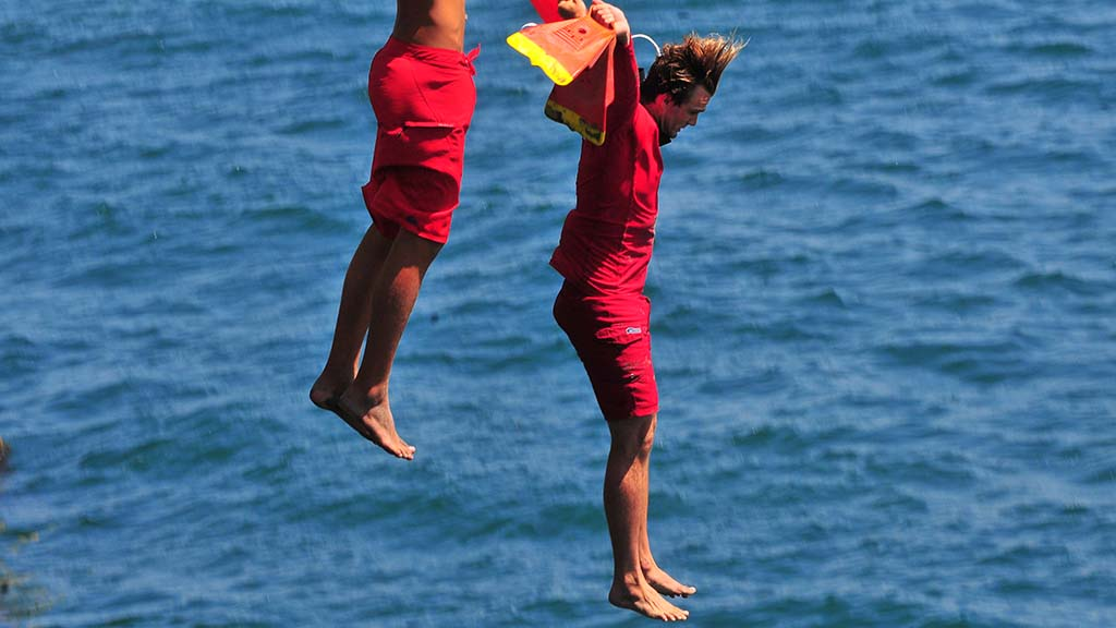 A lifeguard instructor takes the plunge with his students in Ocean Beach.