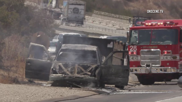 Burned out truck that sparked brush fire