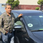 Edhuar Arellano with his car