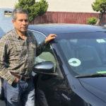 Edhuar Arellano with his car
