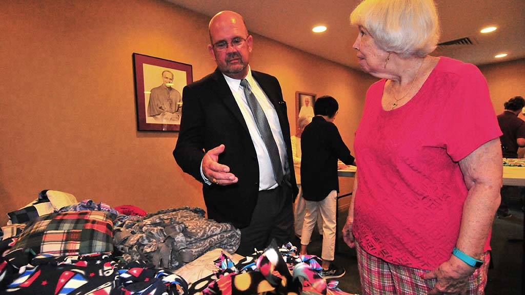 San Diego City Councilman Scott Sherman chats with Sharon Dilloway about the blanket for veterans.