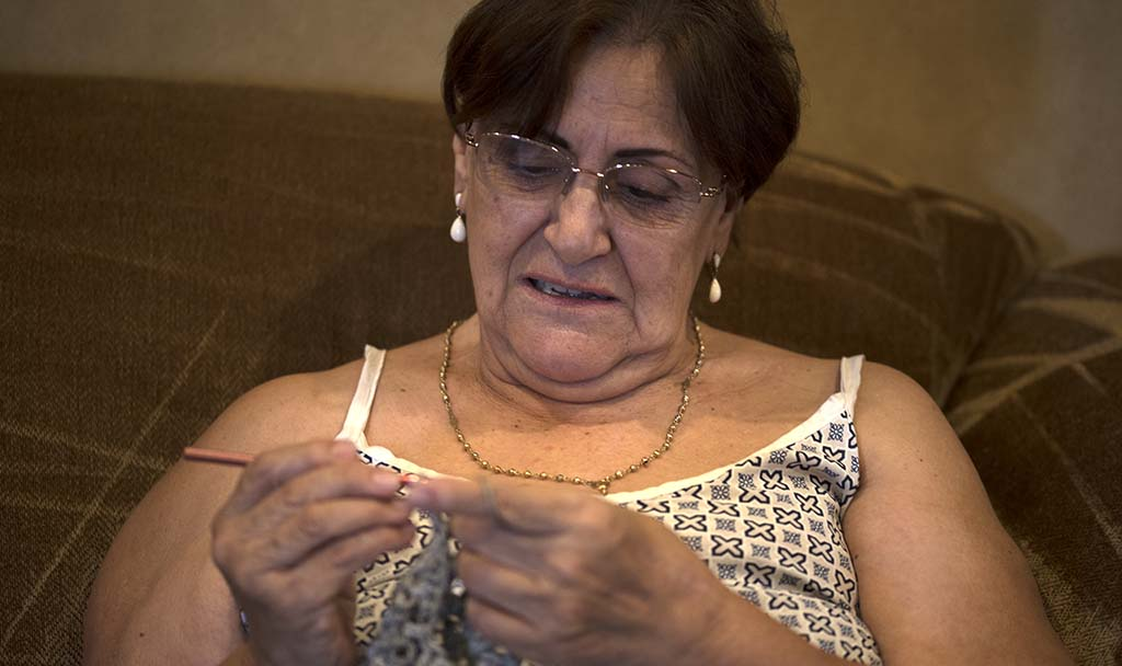 Susana Rivera has learned to knit and crochet while creating items for donations.