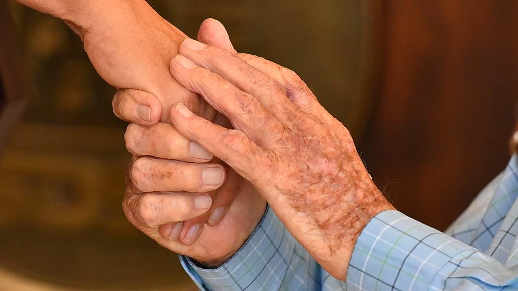Bill Vogt holds the hand of SDSU President Adela de la Torre, as he thanks her.