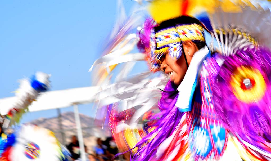 Feathers and ribbons swirl as the dancers perform.