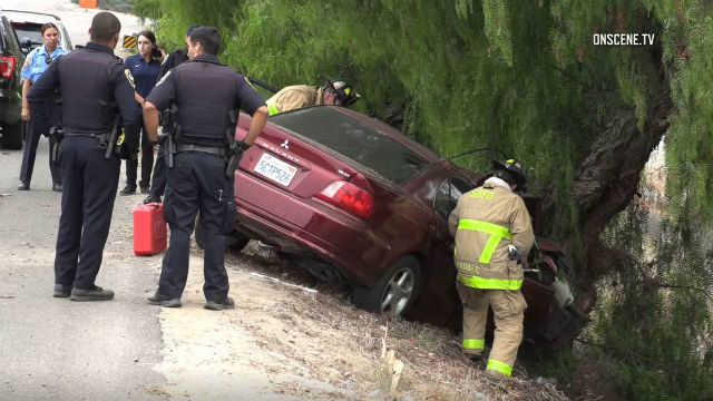 First responders work to free driver and passenger