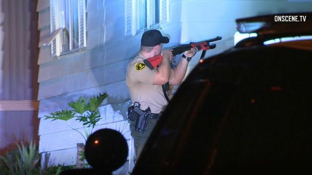 Deputy aims shotgun