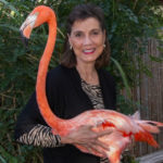 Georgeanne Irvine with a flamingo