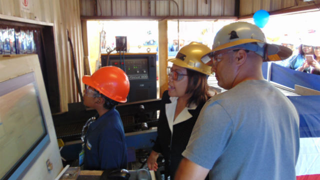Melinda Odermatt watches as steel is cut