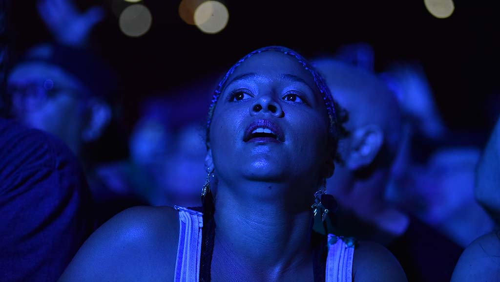 Fan of Foo Fighters is bathed in blue at KAABOO Del Mar.