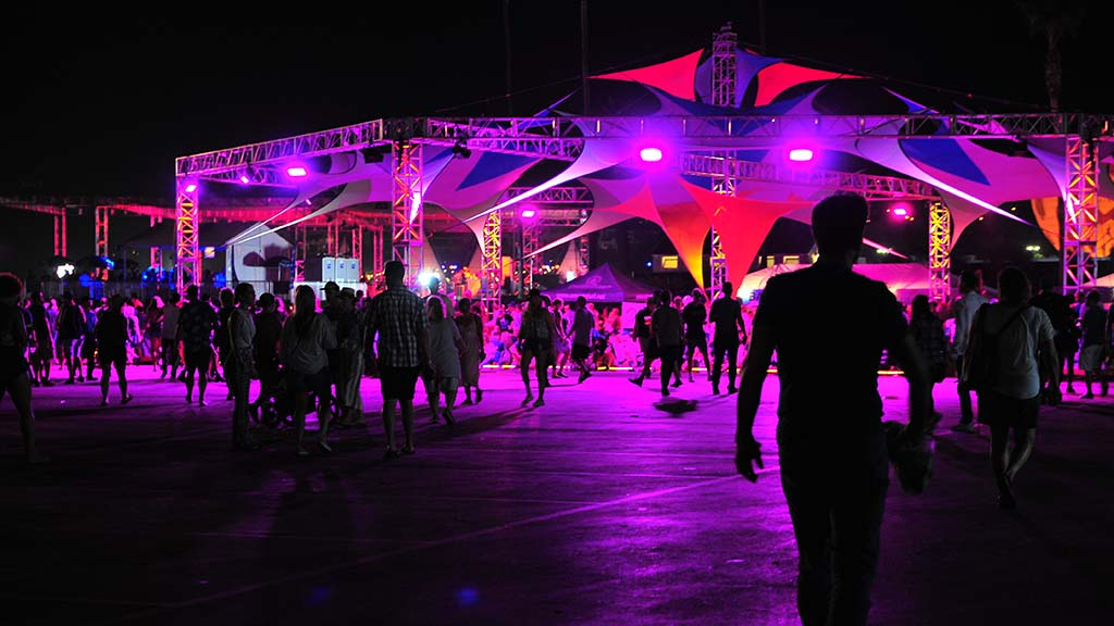 KAABOO spectators move under colorful tents to sit and watch the musical performances.