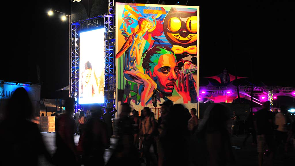 Crowds walk past artwork as they travel in and out of the main stage area at KAABOO.