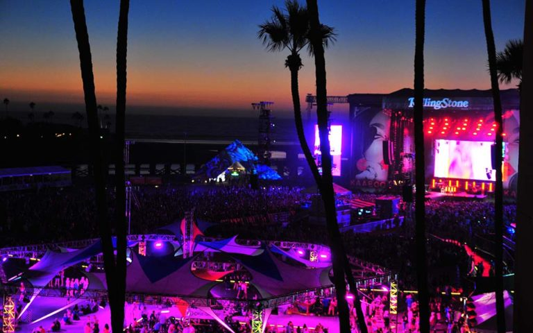 The sun sets on the Sunset Cliffs Stage at KAABOO as seen from the grandstands.
