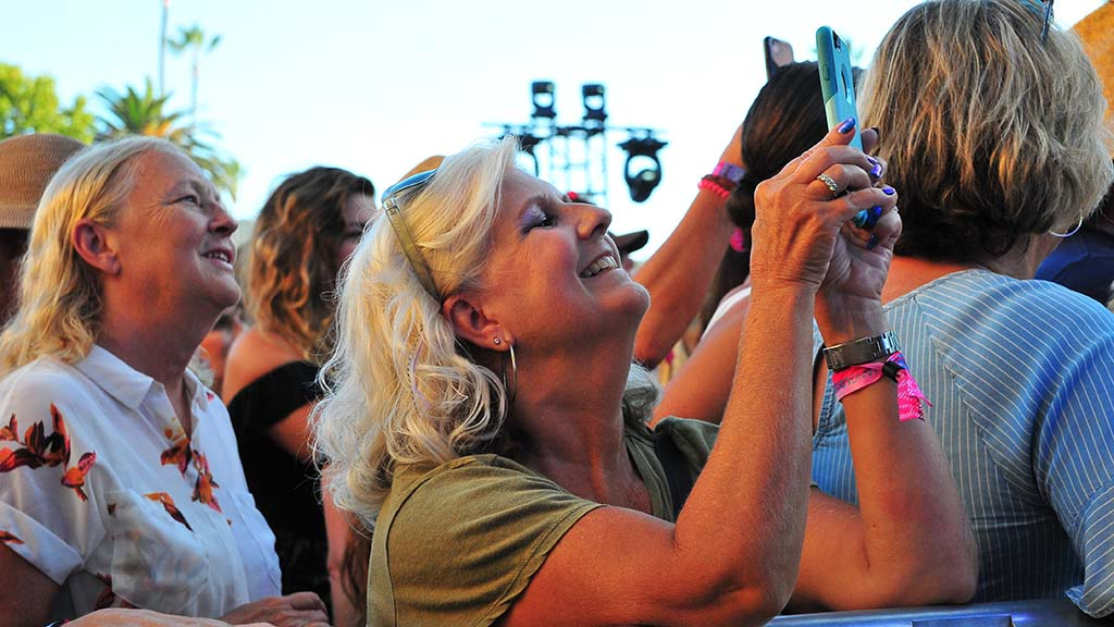 Fans take photos of their favorite musical performers at KAABOO in Del Mar.