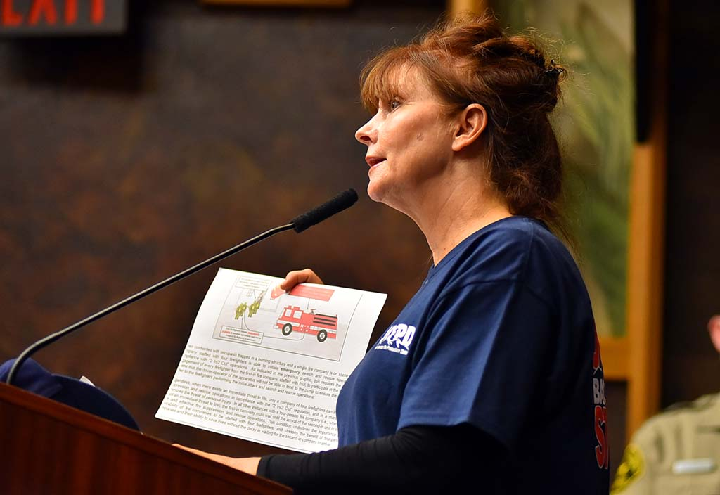 Lorie Foss of Julian, who lost a home to wildfire, argued that both Cal Fire and the volunteer force are needed.