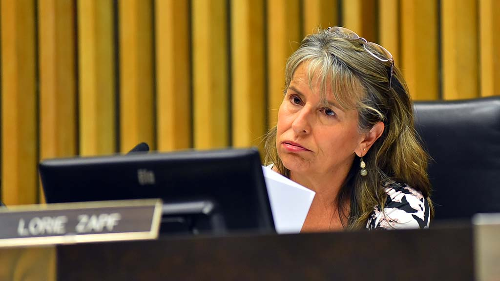 San Diego Councilwoman and LAFCO member Lorie Zapf fans herself on the warm dais.