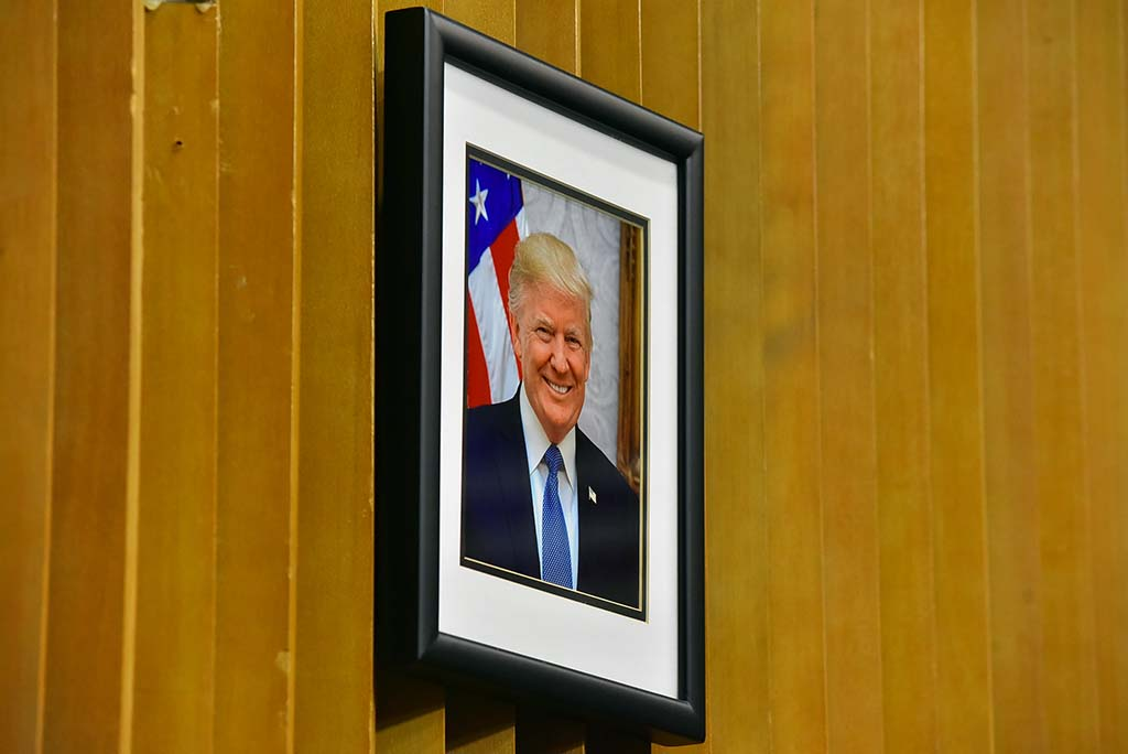 Portrait of President Trump looks down on the LAFCO board and staff.