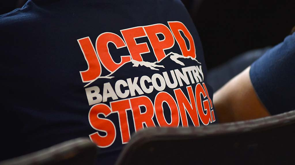 Back of T-shirt shows logo that also appears on a Facebook page.