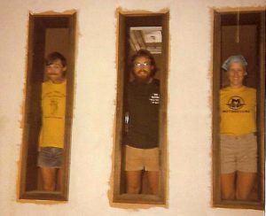 "From left: Rick Vandertie, Carl Brandt and Rick's wife, Lynn, look out windows of Mission Beach store shortly after they arrived in San Diego near Thanksgiving 1977. ""We were in the process of painting and fitting out the store. For a short while, we all lived in the back and ran the shop out of the front at 3838 Mission Blvd. My wife was a nurse and after she started working at University Hospital, we could afford to move into a rental house in PB."""