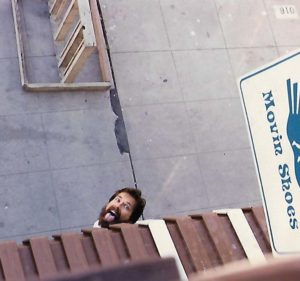 Carl Brandt looks up from in front of Mission Beach store about 1982.
