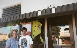 "Rick and Lynn Vandertie in front of the Mission Beach store about 1980. Rick says the neon shorts displayed in the window had a ""brief but brilliant life span of only a few years."""