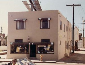 """One of the earliest pictures of the Mission Beach store, about 1978. """"It has our first board sign hanging over the door and the apparel are from Hind-Wells and Moving Comfort, two of the first vendors to supply us."""""""