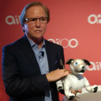 Mike Fasulo with an Aibo