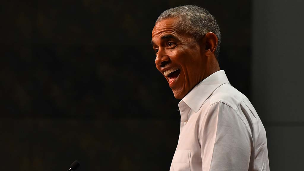 Former President Barack Obama reacts to cheering supporters before his speech in Anaheim.