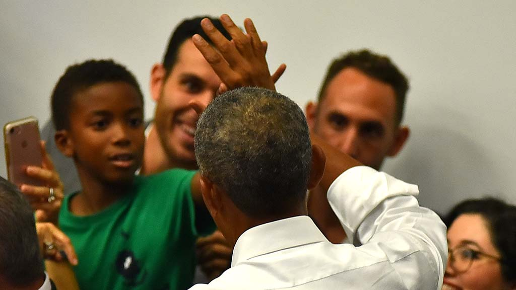 A young boy high fives President Barack Obama at the end of the rally.