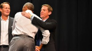 Congressional candidate Mike Levin get a hug from former President Barack Obama.