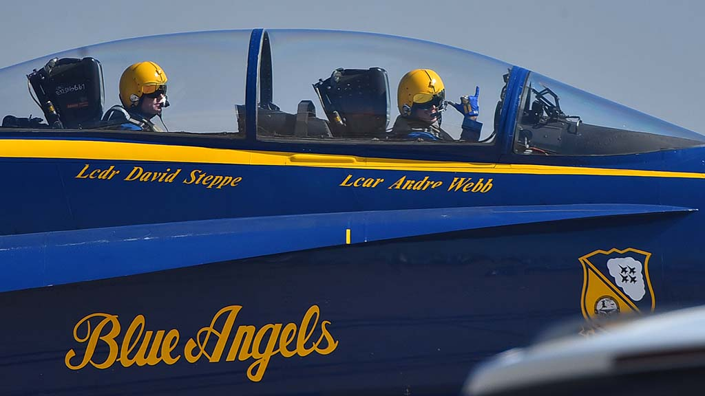 Blue Angel pilot Lt. Andre Webb (right) signals that he is ready for takeoff.