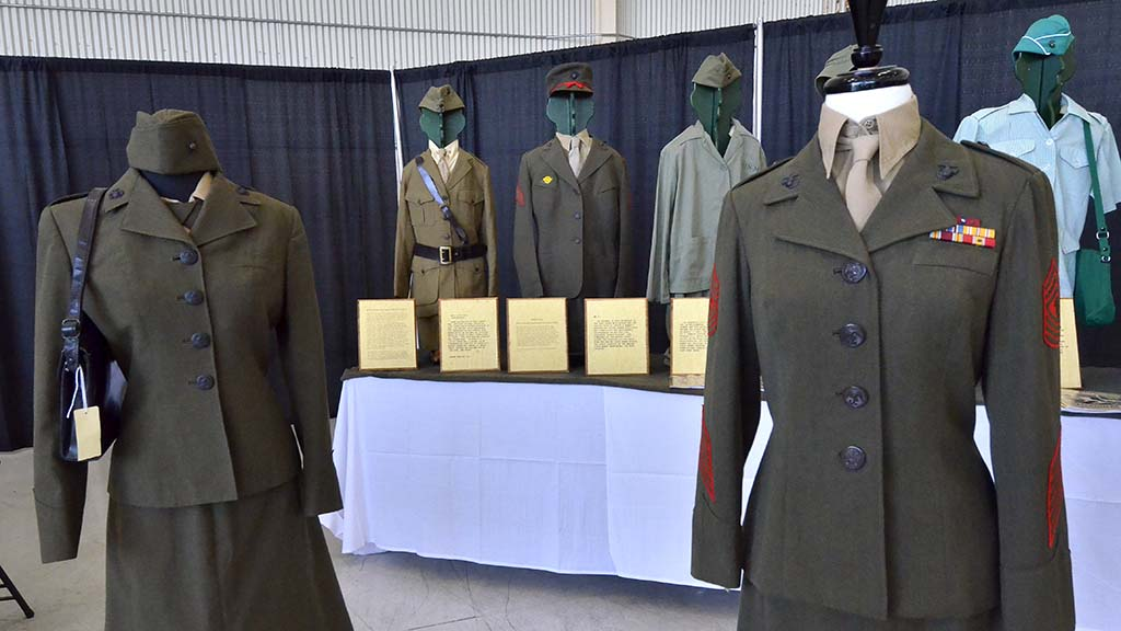 A collection of women Marine uniforms from World War I to the present are on display in the Air Show Expo building.