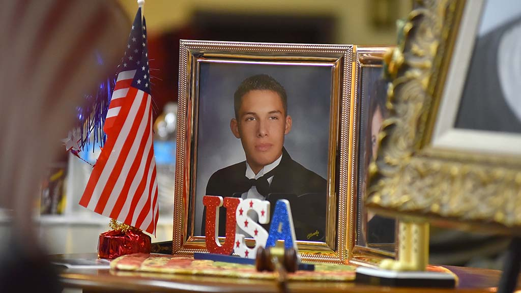 Framed portrait shows Army Spc. Brandon Meyer, killed in January 2008 in Mosul, Iraq.