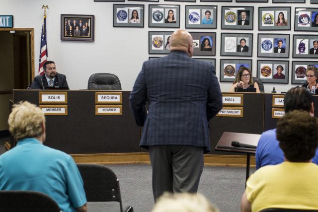 Nicholas Segura's empty seat at board meeting