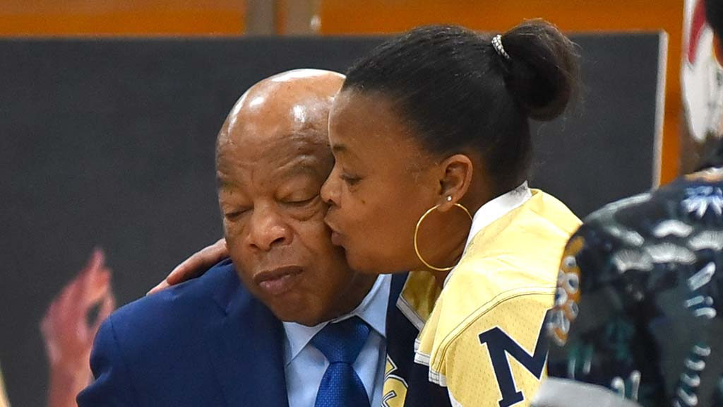 Rep. John Lewis get a kiss from Twylah Tarkington after his talk at Morse High School.