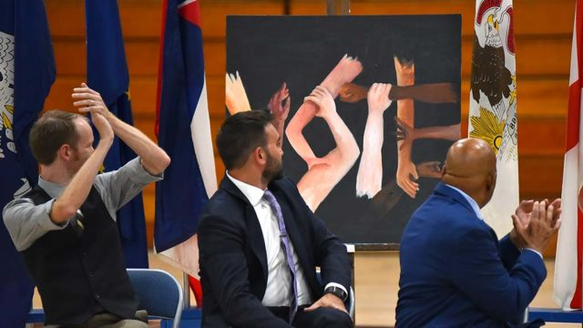 "Rep. John Lewis (right) and fellow ""March"" authors turn to examine (and applaud)  the ""Vote"" painting by Morse High School students."