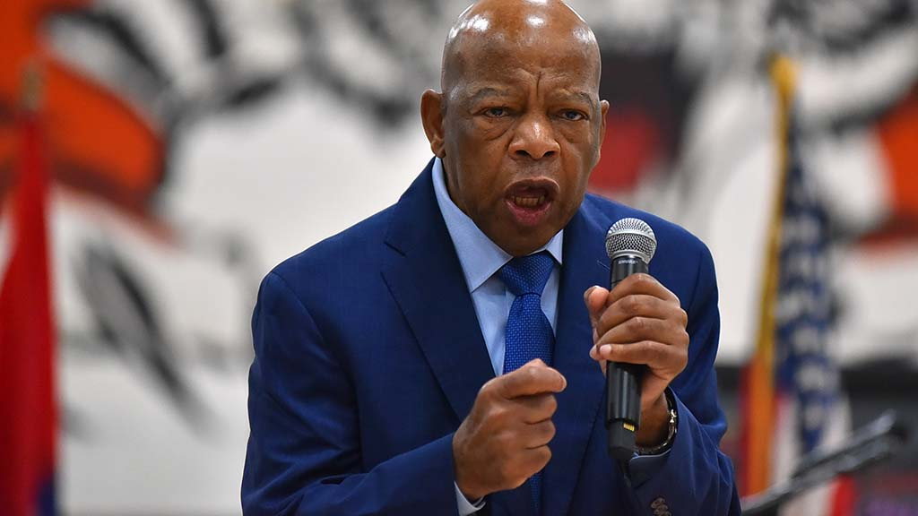Rep. John Lewis of Georgia speaks in the Morse High School gym.