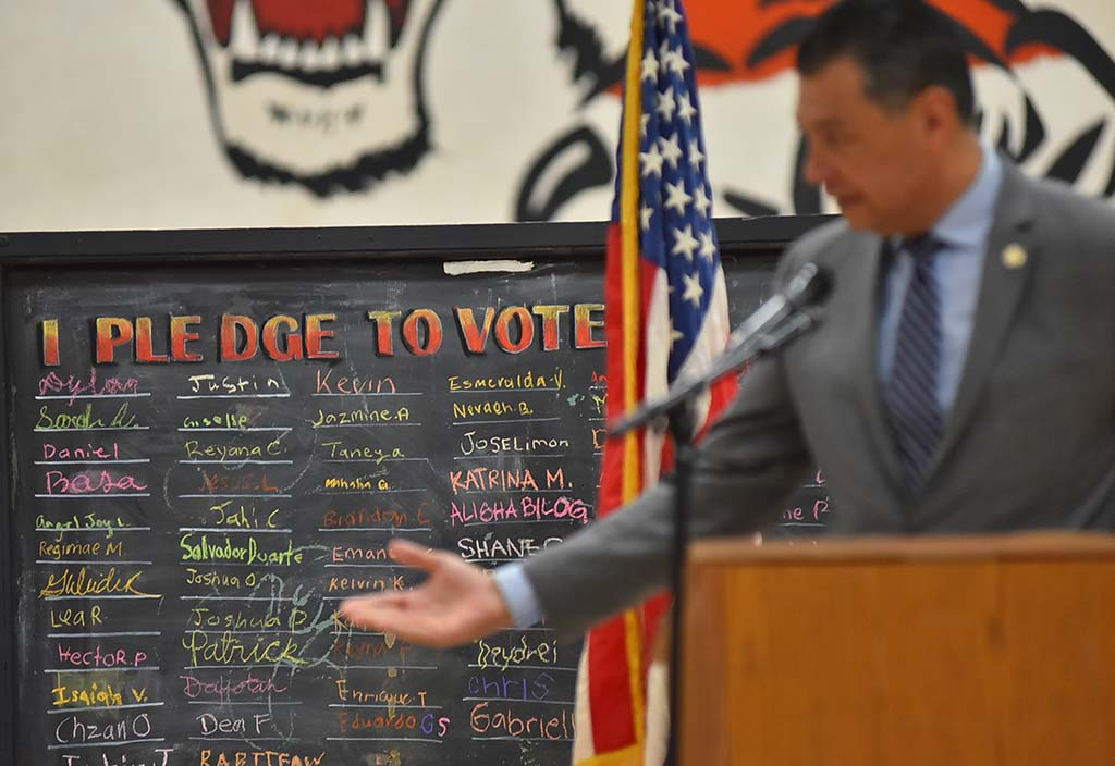 """I pledge to vote"" board was backdrop to Secretary of State Alex Padilla, who oversees statewide elections."