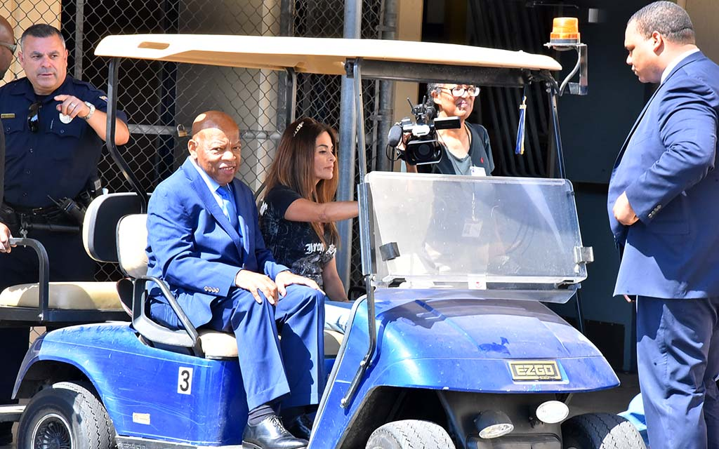 Rep. John Lewis smiles as he waits cart trip back to the Morse High School parking lot after a 90-minute visit.