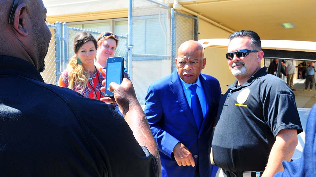 Rep. John Lewis posed with several school and San Diego police officers, including the school district's Chris Padilla.