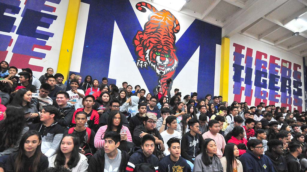 "About 300 students who had read ""March: Book One"" pack the bleachers for John Lewis visit."
