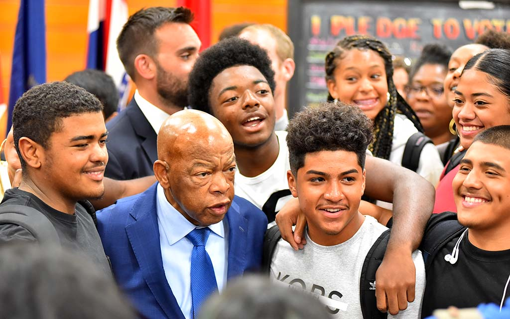 Students swarmed Rep. John Lewis after program and were warmly embraced by the civil rights icon.