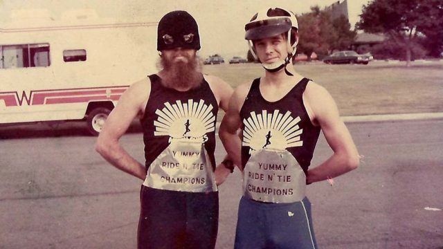 Carl Brandt (left) and Rick Vandertie model the first silk-screened Movin' Shoes singlets.