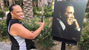 Tonya Bailey of Anaheim gets her closest brush with history before President Obama's rally for Democratic congressional candidates at the Anaheim Convention Center. She didn't have a ticket.