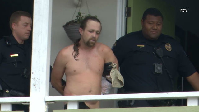 Burglary suspect is led out of motel