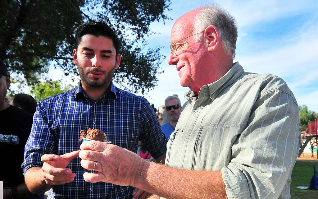 Ben Cohen of Ben and Jerry's Ice Cream gives the first scoop to candidate Ammar Campa-Najjar.