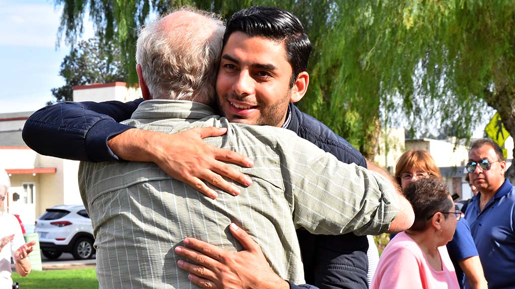 Congressional candidate Ammar Campa-Najjar hugs Ben Cohen who went to Escondido to support his campaign.