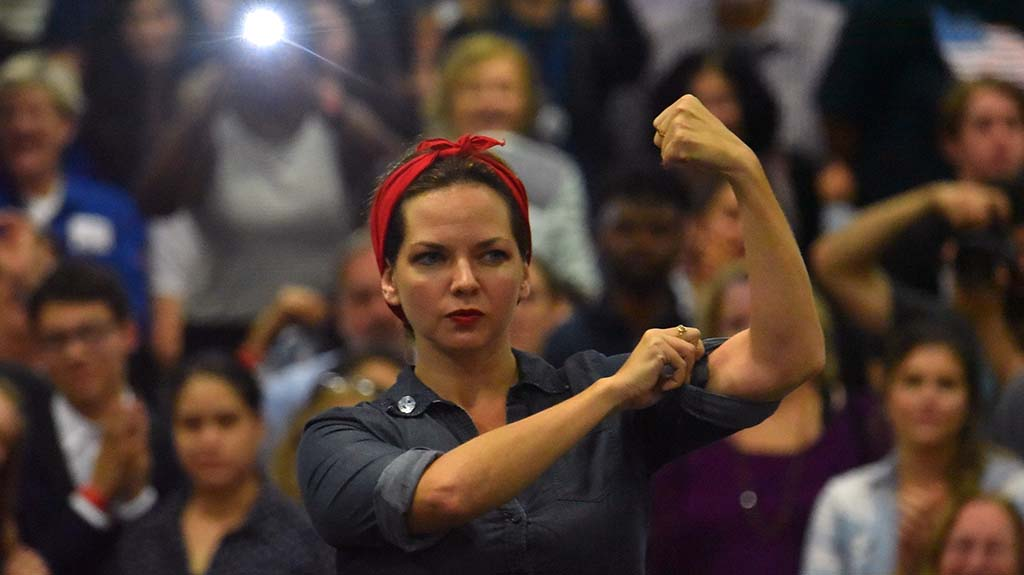 "IBEW Local 569 political director Gretchen Newsom strikes a ""Rosie the Riveter"" pose during her turn on stage."