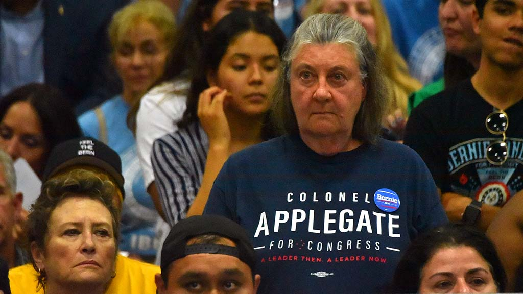 A Bernie Sanders supporter still wears a shirt for Doug Applegate who was defeated by Mike Levin.