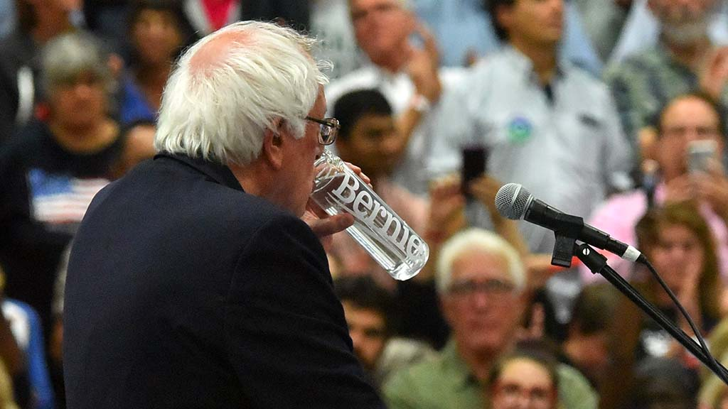 Bernie Sanders drank from his own branded water bottle during speech in warm MiraCosta College gym.