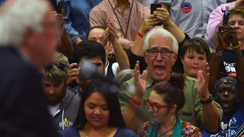 A supporter reacts to a remark by Sen. Bernie Sanders at a rally at MiraCosta College.